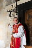 Priest entering church Stock Image