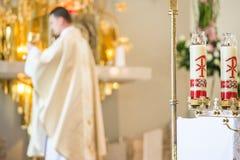 Priest During Eucharist. Catholic Priest Praying During Eucharist. Roman Catholic Church royalty free stock photo