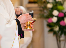 Priest granting the Communion Royalty Free Stock Photos