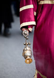 Priest hand. Holding ceremonial thurible Stock Photo