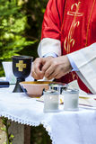 Priest hands during religious celebration Royalty Free Stock Photos