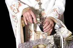 The priest hands with wine Stock Photos
