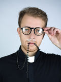 Priest high on drugs Stock Photography