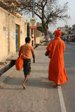 The priest and his disciple. India. Vrindavan, India, March 17: The priest and his disciple walking on the street in March 17, 2013 in Vrindavan, India Stock Image
