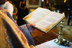 Priest holding bible Stock Photography