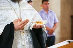 Priest holding bread and wine Stock Photos