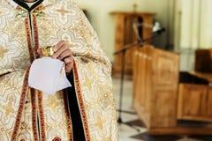 Priest holding chalice for communion, wedding ceremony of happy stock photos