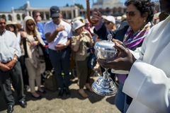 Priest holding a ciborium with sacramental bread at the Sanctuary of Fatima during the celebrations of the apparition of the Virgi Royalty Free Stock Photos