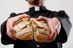 Priest holding loaf of bread royalty free stock photos