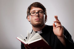 Priest with Holy Bible stock photography