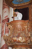 Priest by homily on the pulpit Stock Photos