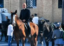 Priest on a horse in St. Peter's square Stock Photo