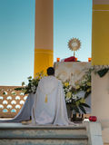 Priest Kneel Down in front of an Altar: Outdoor Church Royalty Free Stock Photography