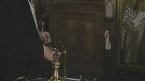 The priest lights the candles stock video footage
