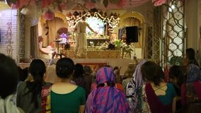 The priest making ceremony in Hare Krishna Temple stock footage