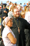 Priest man and a woman watch Borodino battle historical reenactment. Stock Photography