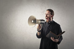 Priest with megaphone Stock Photos