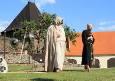 Priest and monk. Theater play 'The Witch' at 'Conquest of water castle Svihov' (Czech Republic, the 1st of July 2016 Stock Photo