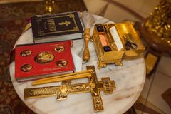 Priest objects for religious ceremony. Bible, prayer book, church candles, cross Stock Images