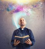 Priest observes universe light Stock Image
