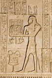 Priest offering to Ancient Egyptian god Ka. Ancient Egyptian bas relief carving of a priest making an offering to the god Ka. Ka is a complex yet vital figure in stock images