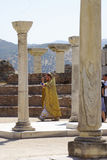 Priest officiating a ceremony in the ruins of St.John`s cathedra Stock Images