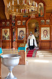 Priest in the Orthodox church Stock Photo