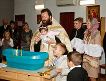 Orthodox christening ceremony Stock Photography