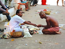 Priest performing religious ceremony with his devotee Stock Photos