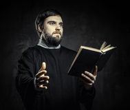 Priest with Prayer book Stock Photos
