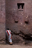 Priest praying outside church in lalibela ethiopia Stock Image