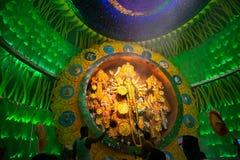 Priest praying to Goddess Durga, Durga Puja festival celebration. Royalty Free Stock Photos