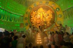 Priest praying to Goddess Durga, Durga Puja festival, Kolkata, India Stock Photos