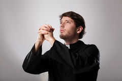 Priest is praying Stock Photography
