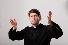 Priest is preaching a sermon. Young christian priest is preaching a sermon Stock Photography