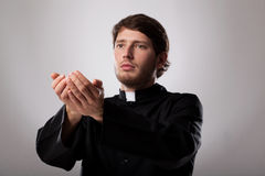 Priest is preaching a sermon. Young christian faithful priest is preaching a sermon Stock Photos
