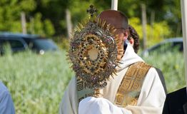 Priest with precious monstrance Stock Photos