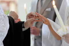 Priest putting the ring on bride's finger. Priest is putting the ring on bride's finger during orthodox wedding ceremony Stock Images
