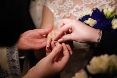 Priest putting a ring on bride's finger Royalty Free Stock Photography