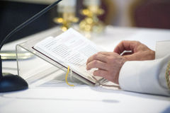 Priest reading a bible stock image