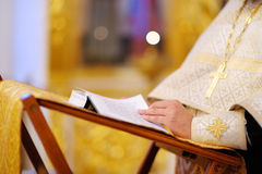 Priest reading church book Royalty Free Stock Photography