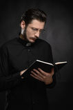 Priest reading the Holy Bible. Portrait of priest reading the Ho Royalty Free Stock Images