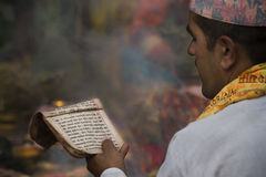 Priest reading prayers during hindu ceremony Stock Photography