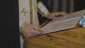 The priest reads a prayer in the church stock video footage