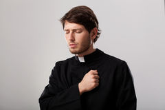 Priest is regretting for sins. Young christian priest is regretting for sins Royalty Free Stock Photos
