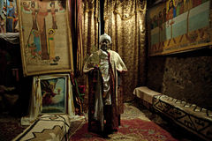 A Priest with religious paintings, Ethiopia Stock Photography