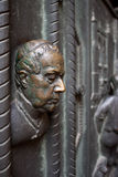 Priest's bust on St. Vitus cathedral's door stock images