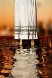 Priest's robe. Priest's white robe reflecting in baptismal font water Royalty Free Stock Photo