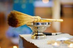 Priest`s wedding accessories during wedding ceremony in a church. Priest`s wedding accessories during catholic wedding ceremony in a church Stock Image