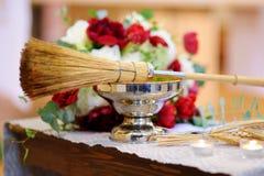 Priest`s wedding accessories during wedding ceremony in a church. Priest`s wedding accessories during catholic wedding ceremony in a church Stock Photos